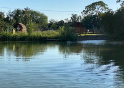 Glamping Pods across the fishing lake